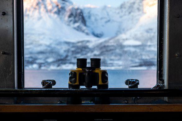 Binoculars in Wild Seas Boat